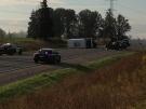 A shuttle bus and car collided on Highbury Avenue near St. Thomas, Ont., on Thursday, Oct. 17, 2013. (Bryan Bicknell / CTV London)
