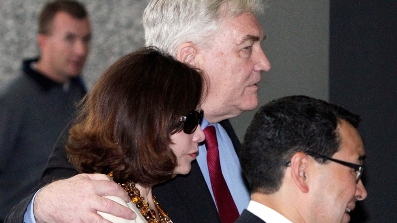 Conrad Black and his wife Barbara Amiel Black listen to attorney Miguel Estrada as they leave federal court in Chicago, Friday, June 24, 2011. (AP / M. Spencer Green)