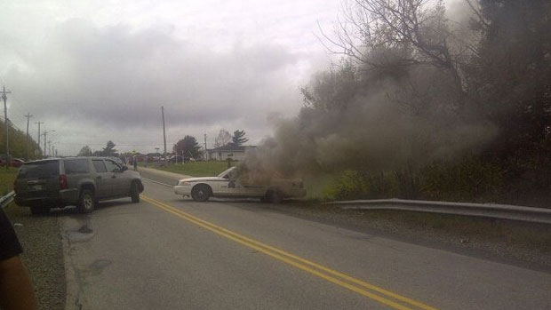 RCMP vehicles on fire shale gas protest