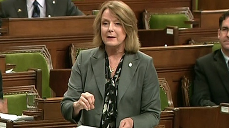 Peggy Nash, MP for Parkdale-High Park, stands and speaks during the debate in the House of Commons in Ottawa, Friday, June 24, 2011.