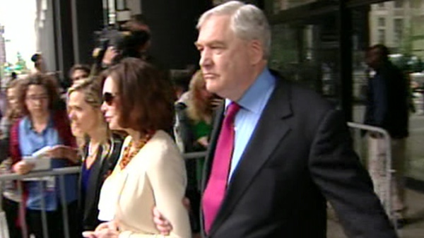 Conrad Black and his wife, Barbara Amiel, emerge from a Chicago court following his sentencing, Friday, June 24, 2011.