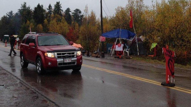 Traffic along New Brunswick highway is slowed by anti-fracking protesters.