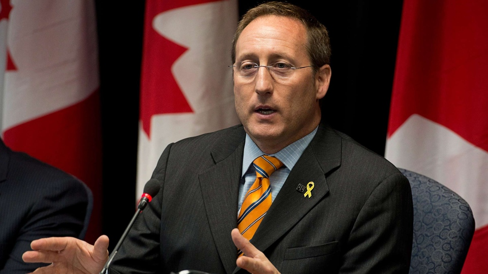 Justice Minister Peter MacKay fields a question on the shale gas protest in New Brunswick as he attends a roundtable discussion on crime in Halifax on Friday, Oct.18, 2013. (Andrew Vaughan / THE CANADIAN PRESS)