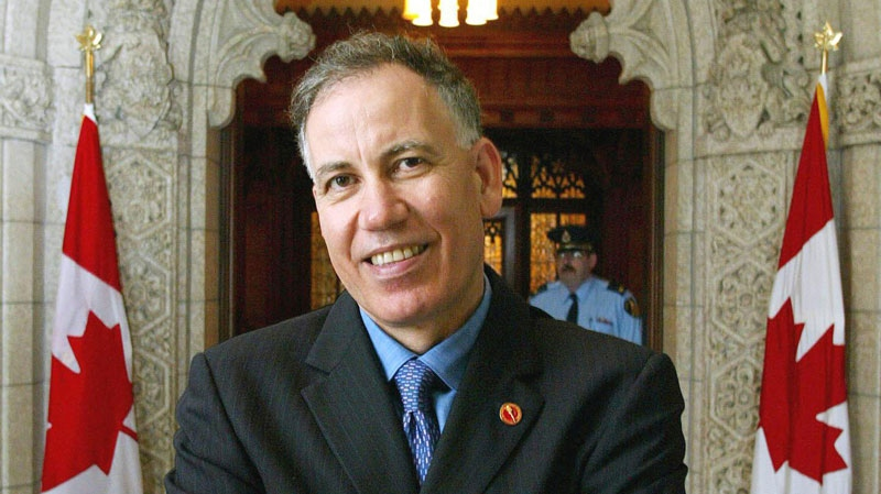 Mac Harb stands outside the Senate chambers after he was sworn-in as senator on September 23, 2002. (Fred Chartrand / THE CANADIAN PRESS)