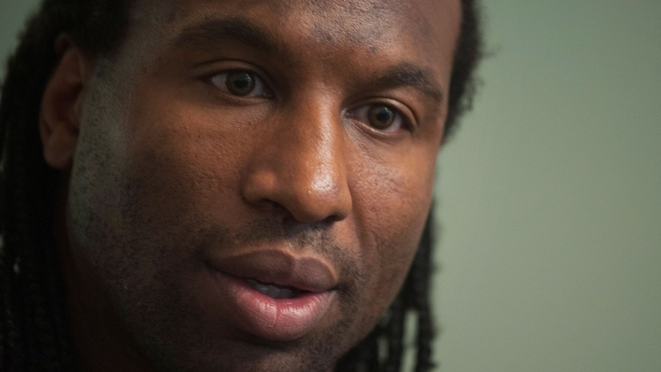 Former NHL tough guy Georges Laraque speaks at a news conference in Montreal, Friday, Oct. 18, 2013. (Graham Hughes / THE CANADIAN PRESS)
