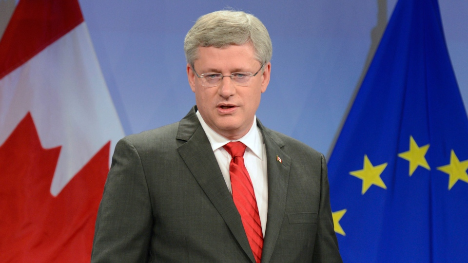 Prime Minister Stephen Harper speaks as he announces a free-trade agreement between Canada and Europe during a press conference in Brussels on Friday Oct. 18, 2013. (Adrian Wyld / THE CANADIAN PRESS)