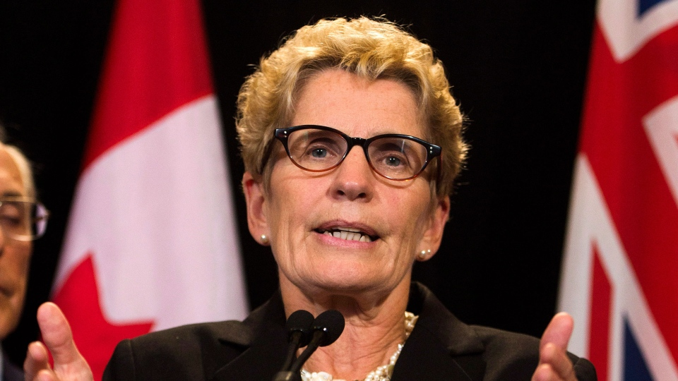 Ontario Premier Kathleen Wynne speaks to the media regarding the cancellation of two southern Ontario gas plants at Queen's Park in Toronto on Tuesday, Oct. 8, 2013. (Nathan Denett / THE CANADIAN PRESS)