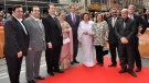 Family of famed Bollywood star Raj Kapoor (left to right) sons Rishi Kapoor, Rajiv Kapoor, Randhir Kapoor, Ritu Nanda (daughter), Premier Dalton McGuinty, his widow Krishna Raj Kapoor, Reema Jain (daughter), Manoj Jain (son-in-law), actor and host Anupam Kher, and TIFF's Noah Cowan stand for a photo on the red carpet during the Raj Kapoor Family Tribute event on Sunday, June 26, 2011 during the IIFA Film Festival at the TIFF Bell Light Box in Toronto. (Aaron Vincent Elkaim / THE CANADIAN PRESS)