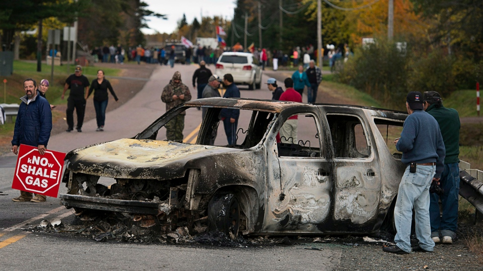 A police vehicle is seen in Rexton, N.B. as police began enforcing an injunction to end an ongoing demonstration against shale gas exploration in eastern New Brunswick on Thursday, Oct.17, 2013. (Andrew Vaughan / THE CANADIAN PRESS)