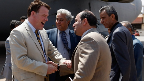 Foreign Affairs Minister John Baird arrives at Benina airport in Benghazi, Libya, Monday, June 27, 2011. (AP / Hassan Ammar)