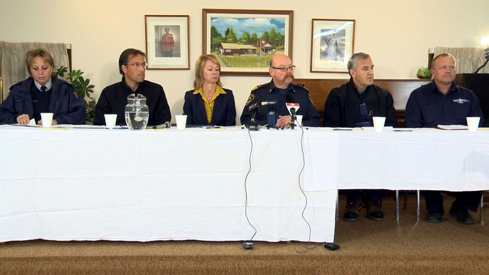 Officials update the public on the train derailment that happened in Gainford, Alta. on Saturday, Oct. 19, 2013.