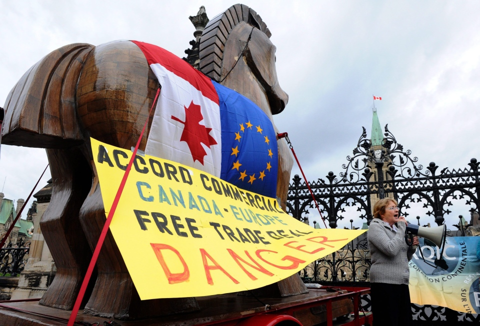 Civil Society Critics of Canada-EU trade deal deliver a Trojan horse to Parliament Hill in Ottawa on Tuesday, Oct. 11, 2011. (Sean Kilpatrick / THE CANADIAN PRESS)