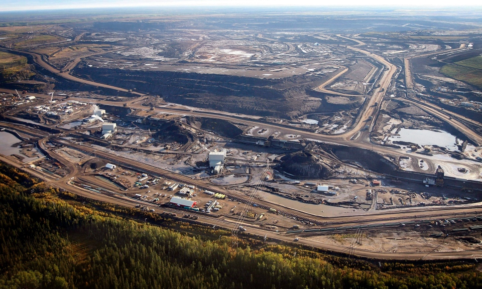 This Sept. 19, 2011 aerial photo shows an oilsands mine facility near Fort McMurray, in Alberta, Canada. (The Canadian Press/Jeff McIntosh)