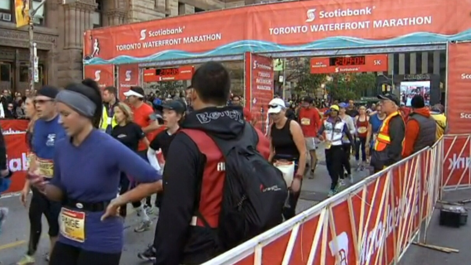 Runners cross the finish line after completing the Scotiabank Toronto Waterfront Marathon on Sunday, Oct. 20, 2013.