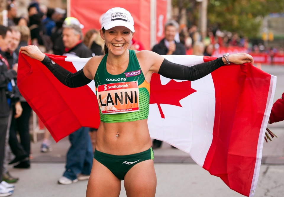 Lanni Marchant celebrates after crossing the line to set a new Canadian record at the Toronto Waterfront Marathon on Sunday with a time of 2:27:59 on Sunday October 20, 2013. (Frank Gunn / THE CANADIAN PRESS)