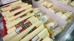 Canadian cheese is on display for sale in Toronto on Friday, Oct. 18, 2013. THE CANADIAN PRESS/Nathan Denette