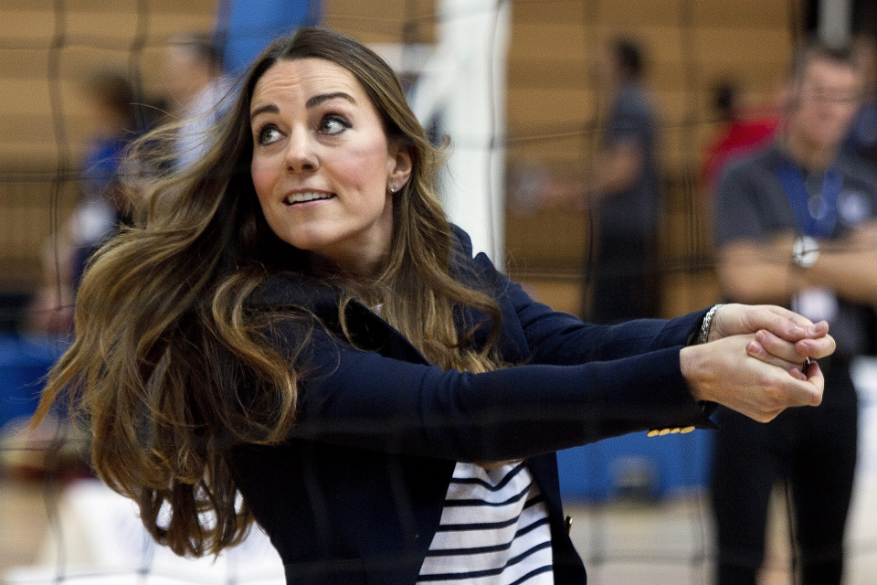 Britain's Kate, The Duchess of Cambridge plays volleyball during a visit to a SportsAid Athlete Workshop, at the Queen Elizabeth Olympic Park in London, Friday, Oct. 18, 2013. (AP / David Bebber)