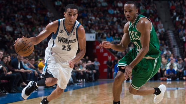 Minnesota Timberwolves' Kevin Martin, left, drives