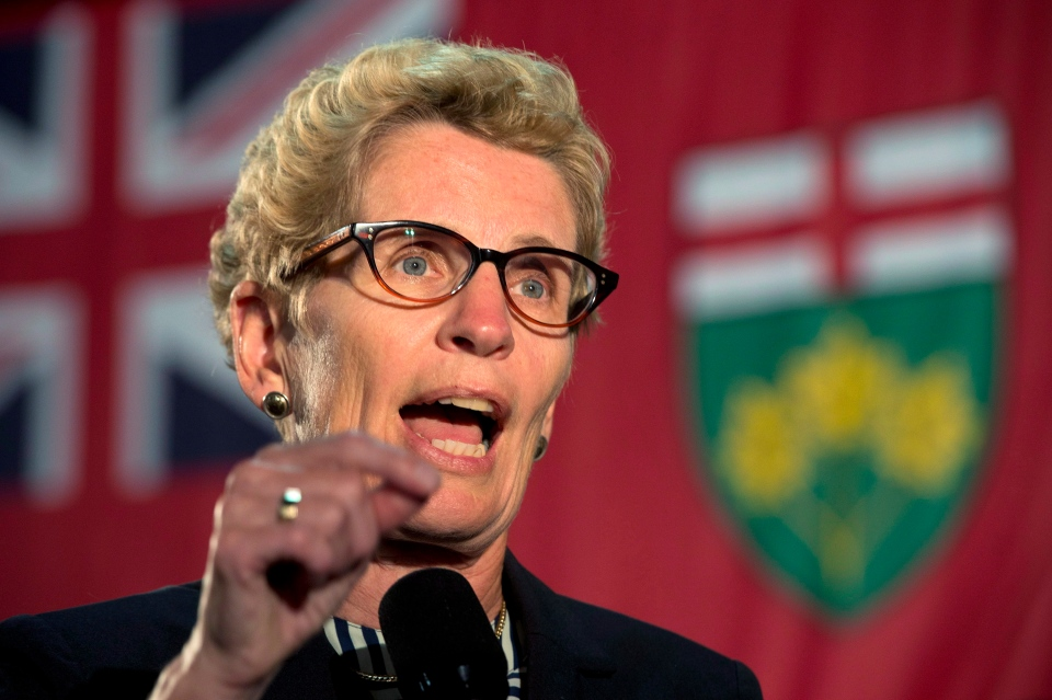 Ontario Premier Kathleen Wynne answers questions in Oakville, Ont., on Thursday, Sept. 19, 2013. (Frank Gunn / THE CANADIAN PRESS)
