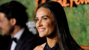 Actress Demi Moore arrives at the Wallis Annenberg Center for the Performing Arts Inaugural Gala in Beverly Hills, Calif., on Thursday, Oct. 17, 2013. (Chris Pizzello/Invision)