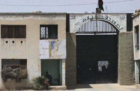 File photo of the gate of the prison in Kandahar province, south of Kabul, Afghanistan, May 11, 2008. (Allauddin Khan, The Associated Press)