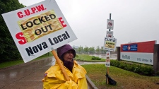 A locked out Canada Post employee pickets outside the main postal facility in Halifax on Saturday, June 25, 2011. (Andrew Vaughan / THE CANADIAN PRESS)