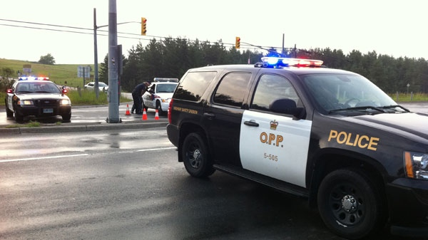 A police officer was struck by a vehicle while he was on a traffic stop in the Town of East Gwillimbury, Ont., Tuesday, June 28, 2011. (Tom Stefenac / CTV News)