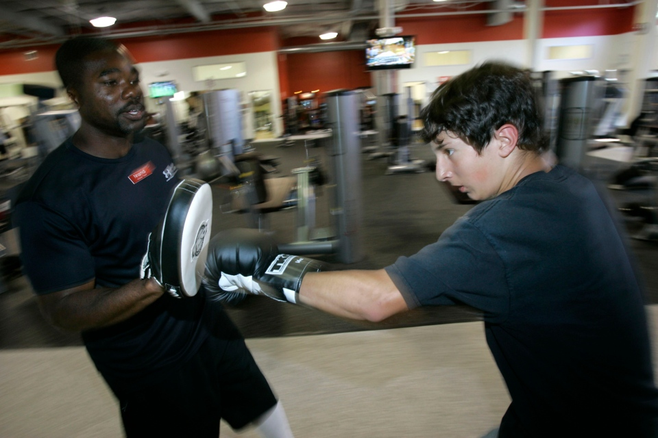 Stephen Wallace, 16, works out with boxing trainer Nnamde Iguagwu at Overtime Fitness in Mountain View, Calif., in this 2007 file photo. (AP Photo/Marcio Jose Sanchez)
