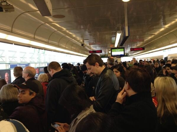 Commuters wait for SkyTrains at Commercial-Broadway Station Tues., Oct. 22, 2013. An issue with the track disrupted service for hours, causing long lines and lengthy delays. (CTV)