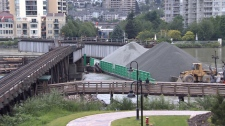Police say the extent of the damage caused when a gravel barge collided with a train bridge in New Westminster has yet to be assessed. June 28, 2011. (CTV)