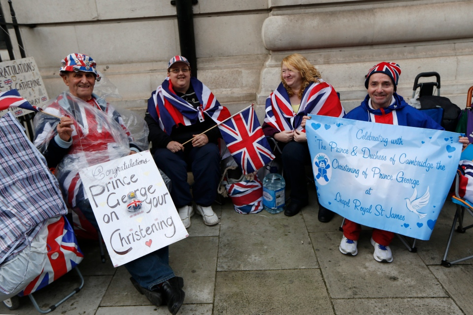 British Royal Family fans from left, Terry Hutt, Julie Cain, Marie Scott and John Loughrey camp up outside the Chapel Royal, St James's Palace in London ahead of the christening of Prince George, Tuesday, Oct. 22, 2013. (AP / Sang Tan)
