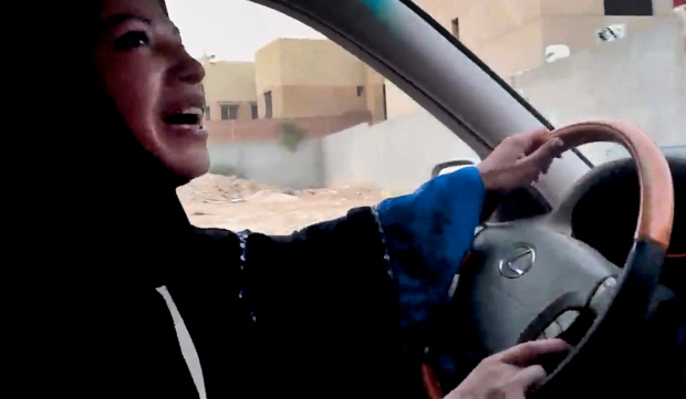 A Saudi Arabian woman drives a car