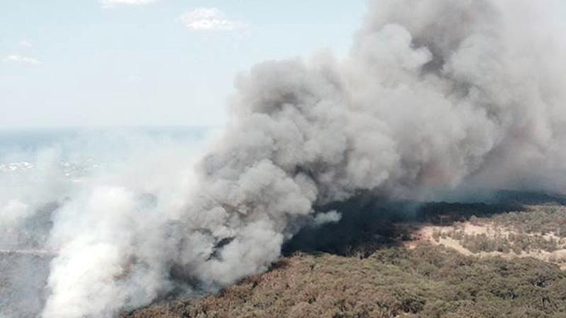 In this photo provided by the New South Wales Rural Fire Service, smoke rises from a wildfire near Lake Macquarie, New South Wales, Australia, Wednesday, Oct. 23, 2013. (AP Photo/NSW Rural Fire Service)