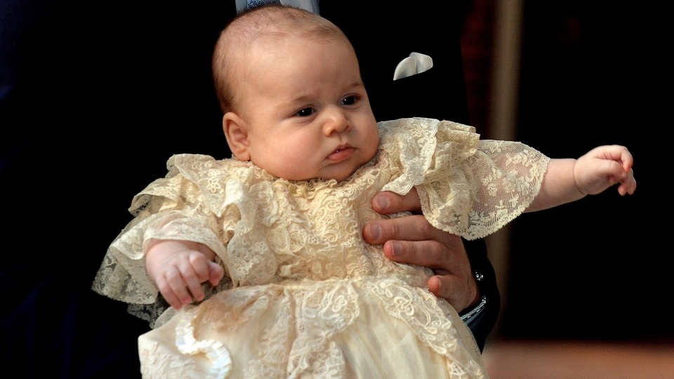 Prince William (not shown), holds his son Prince George as they arrive at Chapel Royal in St James's Palace in London, Wednesday Oct. 23, 2013. (AP / John Stillwell)