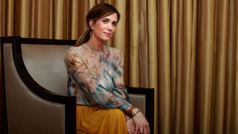 Actress Kristen Wiig poses for photos in Los Angeles, April 29, 2011. (AP / Jae C. Hong)