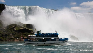 Tourists ride the Maid of the Mist tour boat in Niagara Falls on Friday, June 11, 2010. (AP Photo/David Duprey)