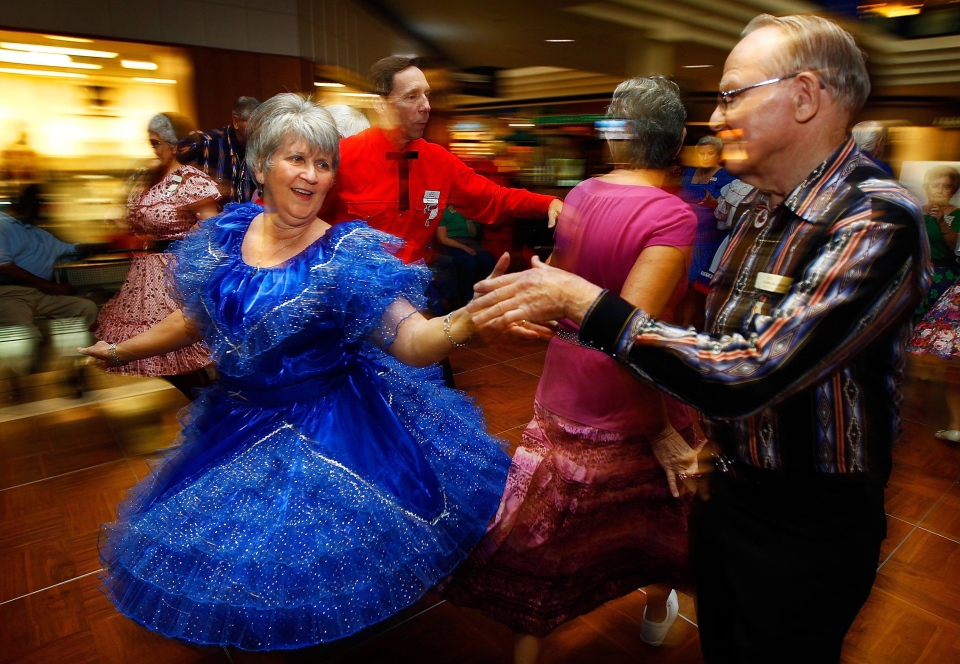 Glinda Torvik takes a turn with Bill Hamblin as they join other dancers with the Greater Memphis Square and Round Dance Association in having a little fun at the Senior Expo and Health Fair Wednesday February 29, 2012 at the Oak Court Mall in Memphis, Tenn.  (AP Photo/The Commercial Appeal, Jim Weber)
