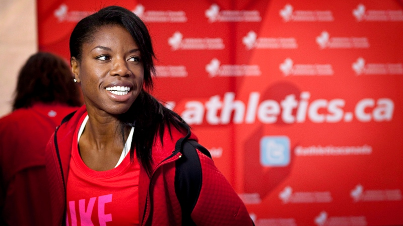 Perdita Felicien, from Pickering, Ont., smiles at a news conference highlighting the upcoming Canadian Track and Field Championships and Olympic Trials in Calgary, Alta., Tuesday, June 26, 2012. (THE CANADIAN PRESS / Jeff McIntosh)