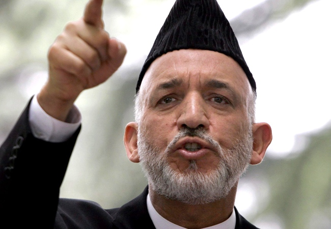 Afghan President Hamid Karzai gestures during a press conference at the presidential palace in Kabul, Afghanistan, Sunday, June 15, 2008. (AP / Rahmat Gul)