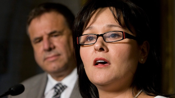 Dr. Alain Beaudet looks on as Health Minister Leona Aglukkaq announces funding for MS treatment in the foyer of the House of Commons on Parliament Hill in Ottawa, Wednesday, June 29, 2011. (Adrian Wyld / THE CANADIAN PRESS)