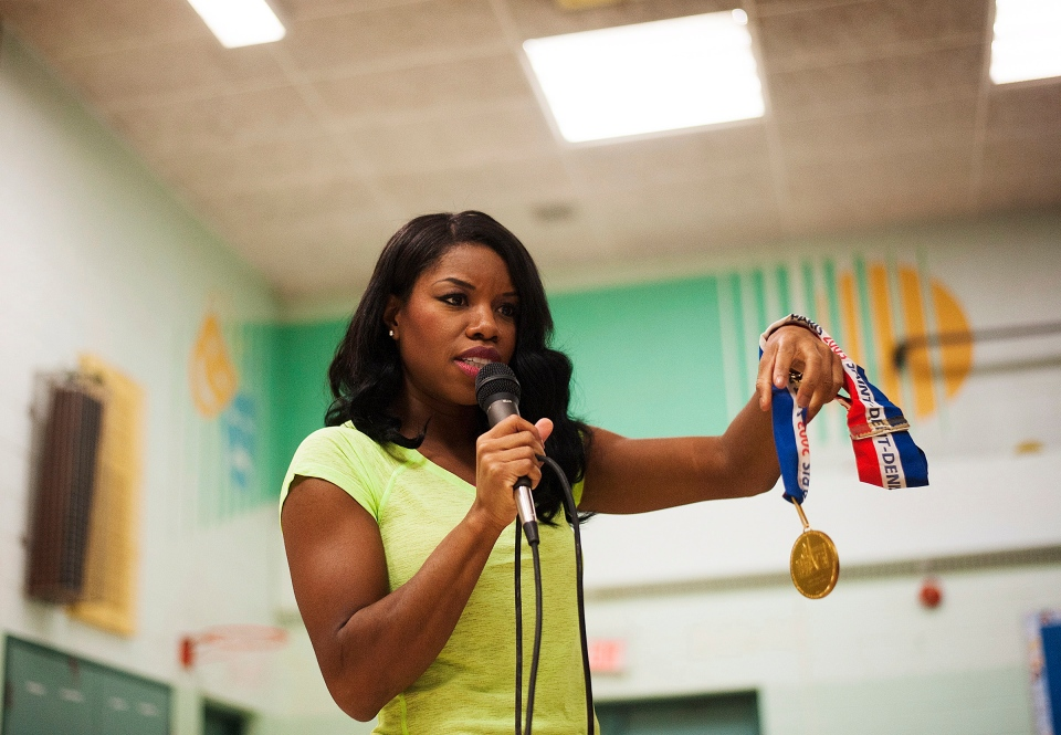 Canadian track star Perdita Felicien announces her retirement from sports at George Webster Elementary School in Toronto on Thursday October 24, 2013. (Aaron Vincent Elkaim / THE CANADIAN PRESS)