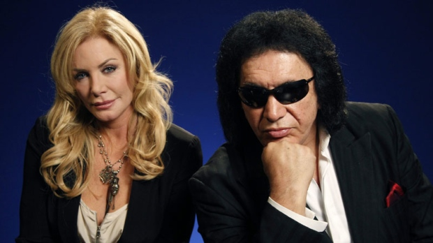 "TV personalities Gene Simmons and Shannon Tweed pose for a portrait Monday, June 13, 2011 in New York. Simmons and Tweed star in the TV reality show ""Gene Simmons Family Jewels"". (AP Photo/Jeff Christensen)"