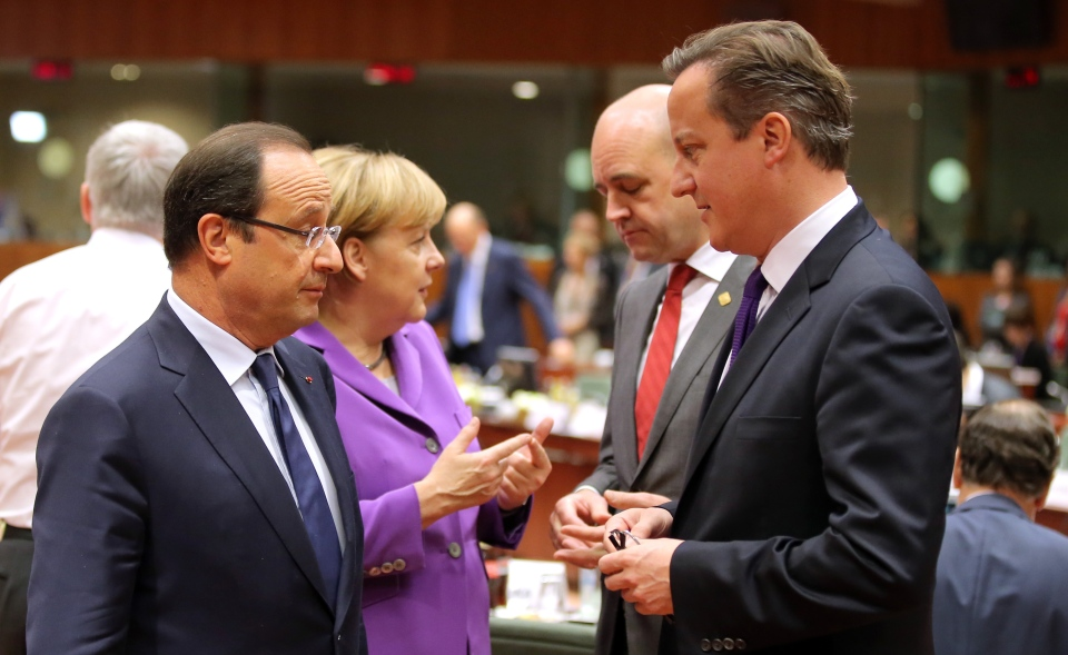 From left, French President Francois Hollande, German Chancellor Angela Merkel, Swedish Prime Minister Fredrik Reinfeldt and British Prime Minister David Cameron speak with each other during a round table meeting at an EU summit on Friday, Oct. 25, 2013. (AP / Michel Euler)