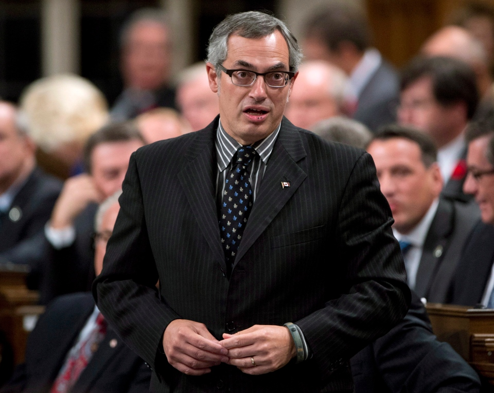 Treasury Board President Tony Clement responds to a question during question period in the House of Commons in Ottawa, Thursday Oct. 24, 2013. (Adrian Wyld / THE CANADIAN PRESS)
