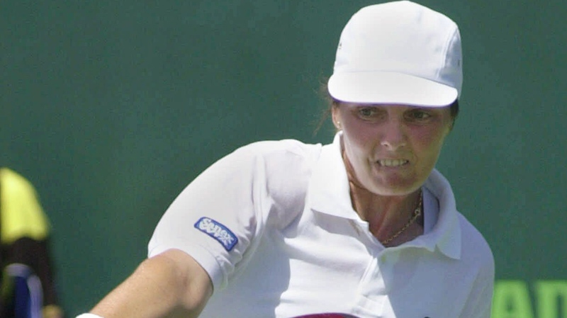 Nathalie Tauziat, of France, returns to Tara Snyder of Wichita, Kan., during the second set at the Ericsson Open in Key Biscayne, Fla., Friday, March 24, 2000. Tauziat defeated Snyder 6-3, 2-6, 7-6. (AP Photo/Marta Lavandier)