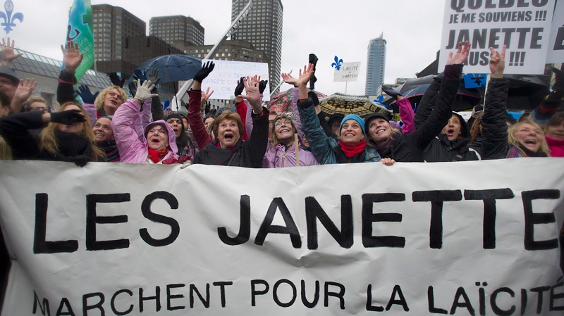 Janette Bertrand, third from left, takes part in a demonstration in support of Quebec's proposed charter of values in Montreal, Saturday, October 26, 2013. If implemented, the charter would ban the wearing of religious clothing and symbols in public institutions. THE CANADIAN PRESS/Graham Hughes