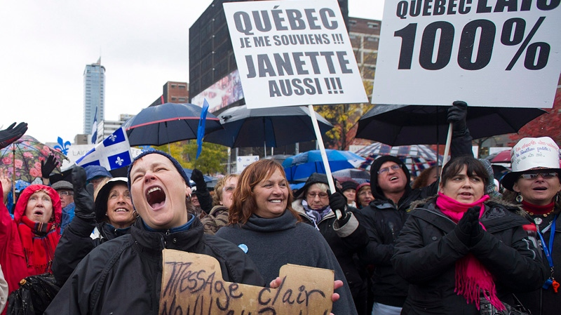 Supporters in favour of Quebec's proposed charter of values gather in Montreal, Saturday, October 26, 2013, prior to taking part in a march. If implemented, the charter would ban the wearing of religious clothing and symbols in public institutions. THE CANADIAN PRESS/Graham Hughes