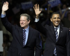 Democratic presidential candidate Sen. Barack Obama, D-Ill., right, waves to the crowd with former Vice President Al Gore at the Joe Lewis Arena in Detroit on Monday, June 16, 2008. (AP / Alex Brandon)