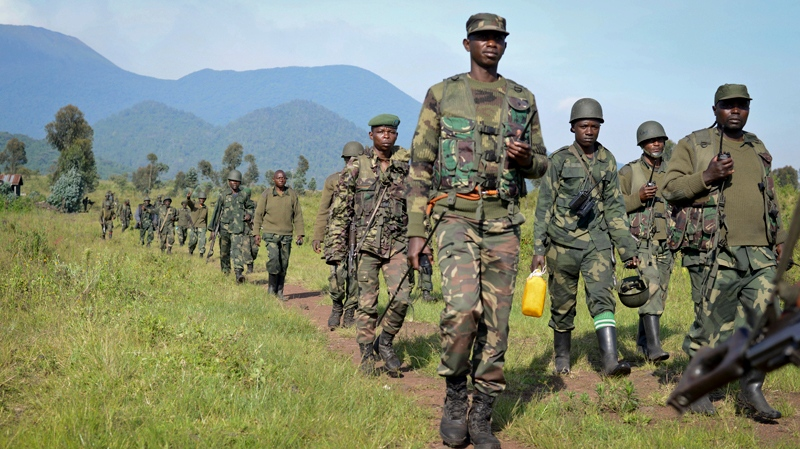 Congolese army soldiers march on a reconnaissance mission near Kibumba Hill, which is occupied by M23 rebels, around 25km from the provincial capital Goma, in eastern Congo Sunday, Oct. 27, 2013. (AP / Joseph Kay)
