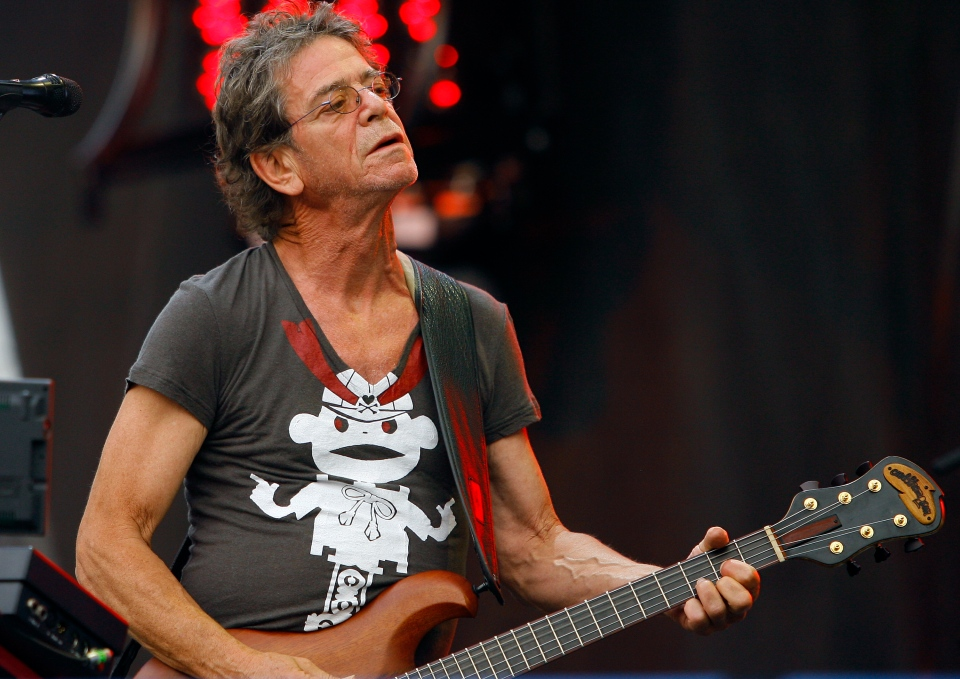 Lou Reed performs at the Lollapalooza music festival, in Chicago on Sunday, Aug. 9, 2009.  (AP / John Smierciak)